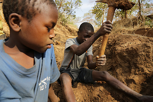 Two 13 year old boys digging for gold in a mine in Mbeya region, Tanzania. (c) 2013 Justin Purefoy