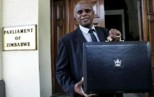 1-zimbabwe-s-acting-minister-of-finance-chinamasa-holds-up-briefcase-containing-government-budget-in-harare_432